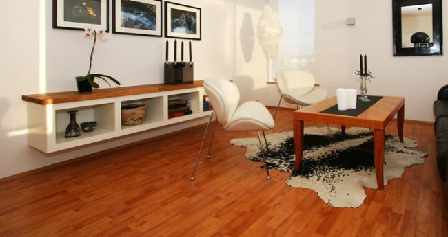 Living room white chairs black leather and couch
